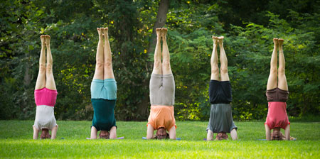 photo of 5 people doing headstand